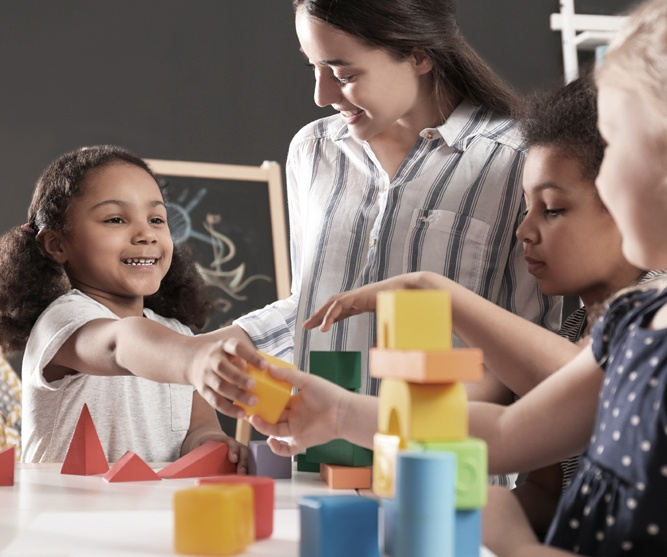 group of children playing with blocks